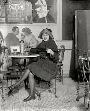 """A woman with her """"tipping cane"""" (i.e., cane flask) in 1922"""