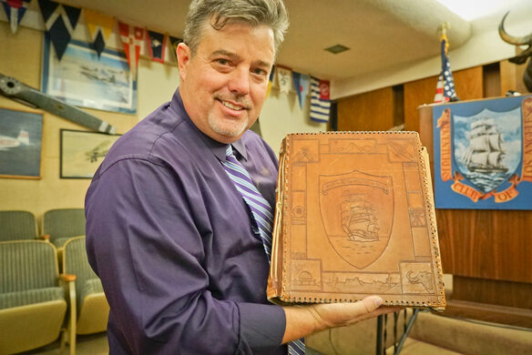 Club President Eric Streit with the Adventurers' Club Membership Book