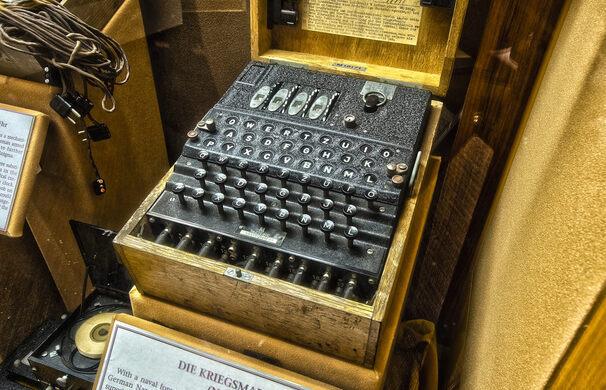 The Enigma machine, developed by Arthur Scherbius in 1923