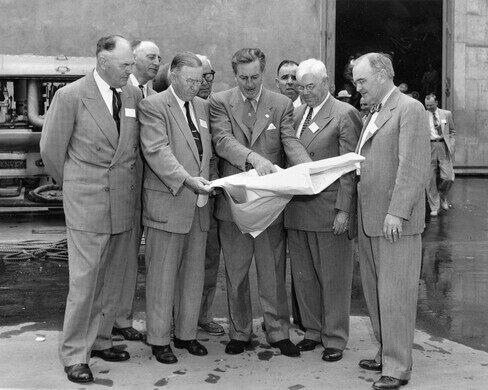 Walt Disney shows Disneyland plans to Orange County officials, Dec. 1954