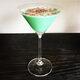 Green crème de menthe gives the Grasshopper its distinctive color and flavor.