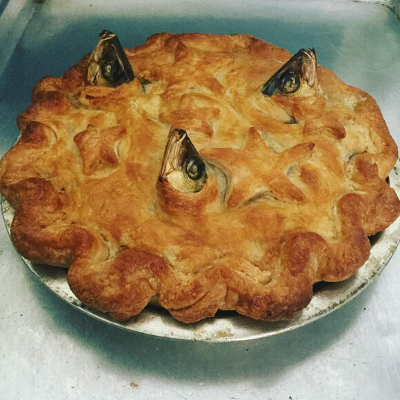 A perfect pie, complete with stars and fish heads.