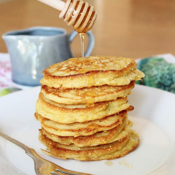 Cornmeal johnnycakes topped with honey.