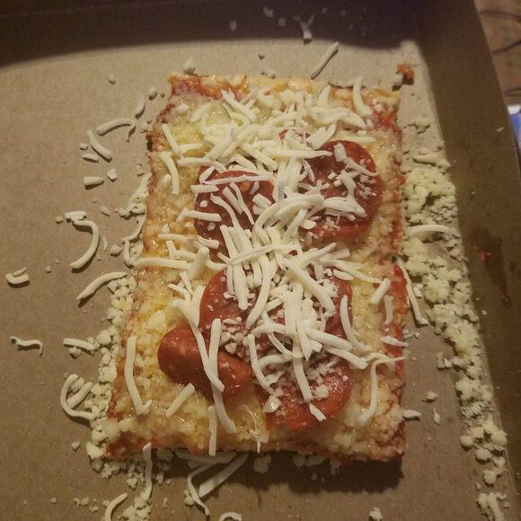 Cold, unmelted mozzarella atop a pepperoni pizza.
