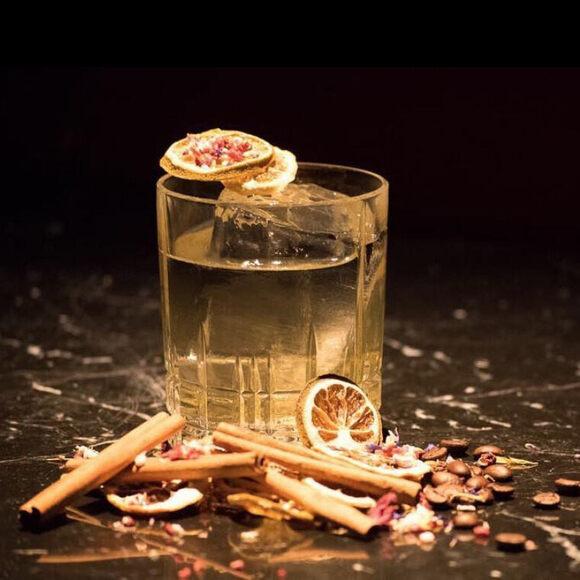 Clarified milk punch made from Hennessy, plum liqueur, hazelnut liqueur, sherry, orgeat, lemon, orange, poppy, cinnamon, vanilla, and coffee.