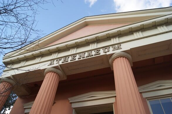 The flamingo-pink Athenaeum, one-time Civil War hospital, and presently the Fine Arts Association.