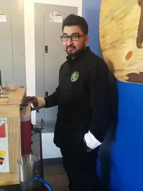 Owner Sean Guerrero pours a brew