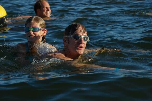Current mayor Ted Wheeler swimming Willamette River.