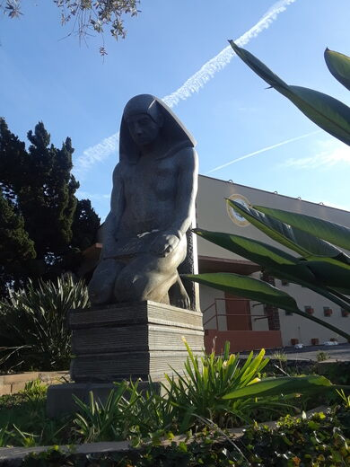 Granite statue of an Egyptian sage.