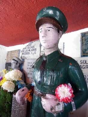Folk saint Juan Soldado at Panteón Puerta Blanca.