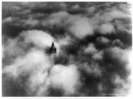 Above the NYC clouds in 1928, the Woolworth not topped yet.