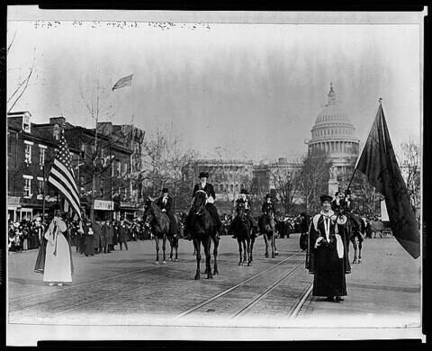 Women suffragists marching on Pennsylvania Avenue led by Mrs. Richard Coke Burleson (center on horseback).