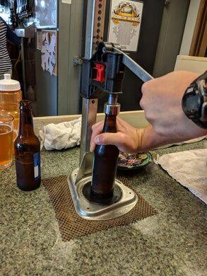 Manually bottling a craft beer.