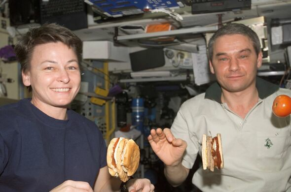 Astronauts eating hamburgers on board the ISS in August 2007.