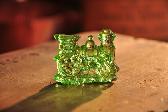 Small green locomotive clear toy candy.