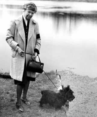 In 1947, walking her husband's dog, Fala, after his death.