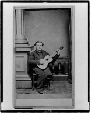 Civil War soldier with a guitar and one leg.