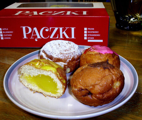 Assorted pączki made in Metro Detroit, USA for Fat Tuesday.