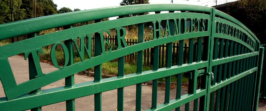 The friendly green cemetery gate.