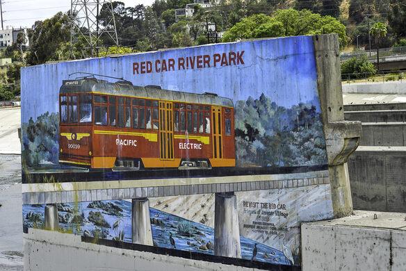 Red car river park mural.
