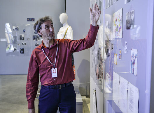 Joes explaining components of the exhibition.