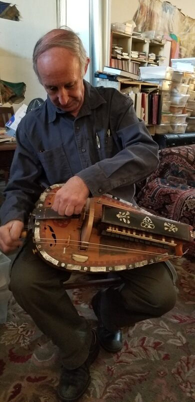 Curtis playing the hurdy gurdy.