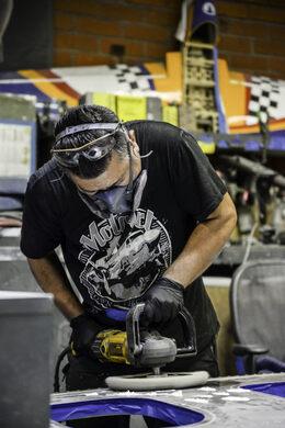 Polishing a piece of metal.