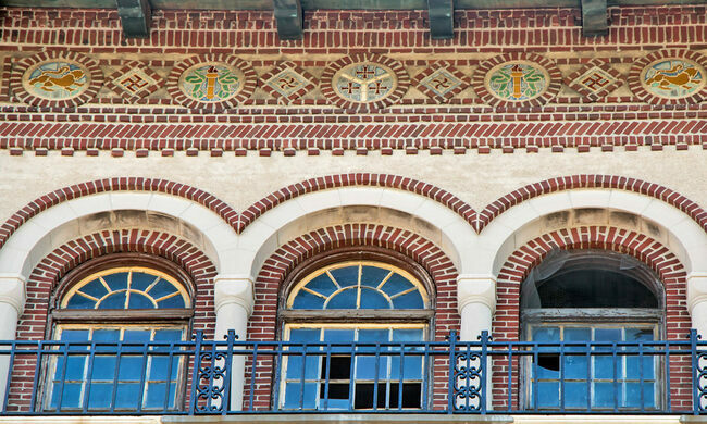 Decorative brickwork featuring the Municipal Device on the outside of one of the buildings.