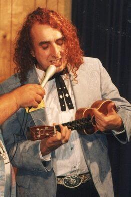 Tiny Tim performing.