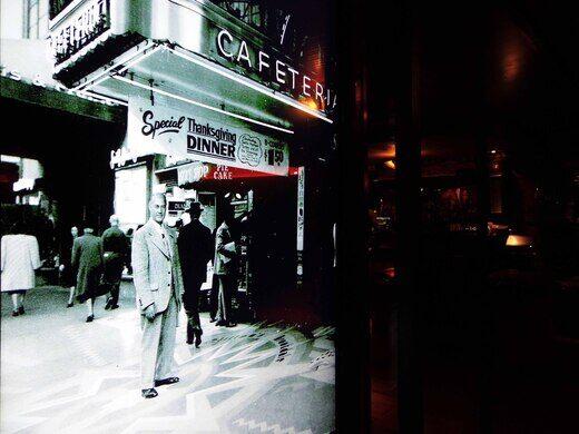 Historic photos lit up inside the bar area.