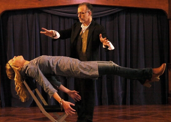 Professional Illusionist Michael Cantori levitating.
