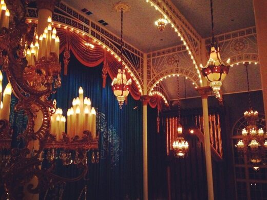 Movie palace chandeliers hang in the living room.