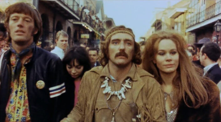 Peter Fonda, Toni Basil, Dennis Hopper, and Karen Black in the 'Easy Rider' Mardi Gras sequence.