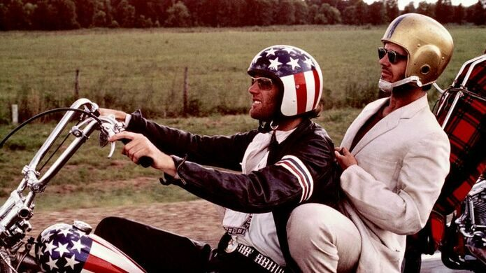 Peter Fonda, Jack Nicholson, and his helmet in 'Easy Rider.'