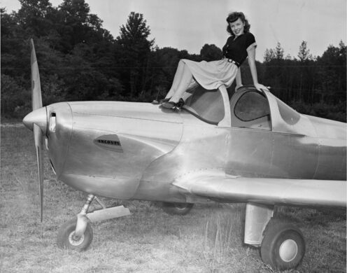 1940s movie star Jane Russell sitting on top of an Ercoupe.