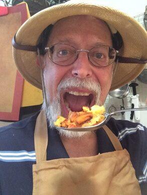 'Wildman' Steve Brill devours a chicken mushroom.