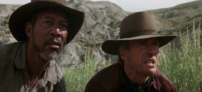 Morgan Freeman and Clint Eastwood look out in 'Unforgiven.'