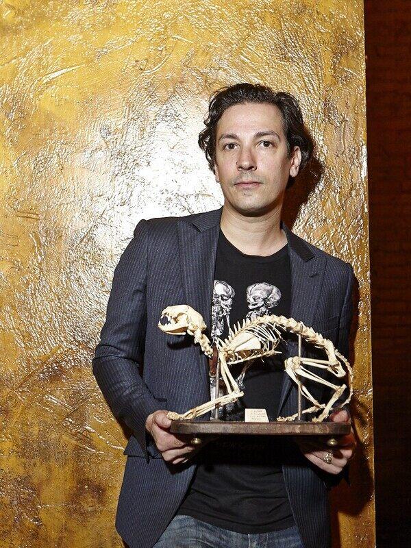 Ryan Matthew Cohn with cat skeleton.