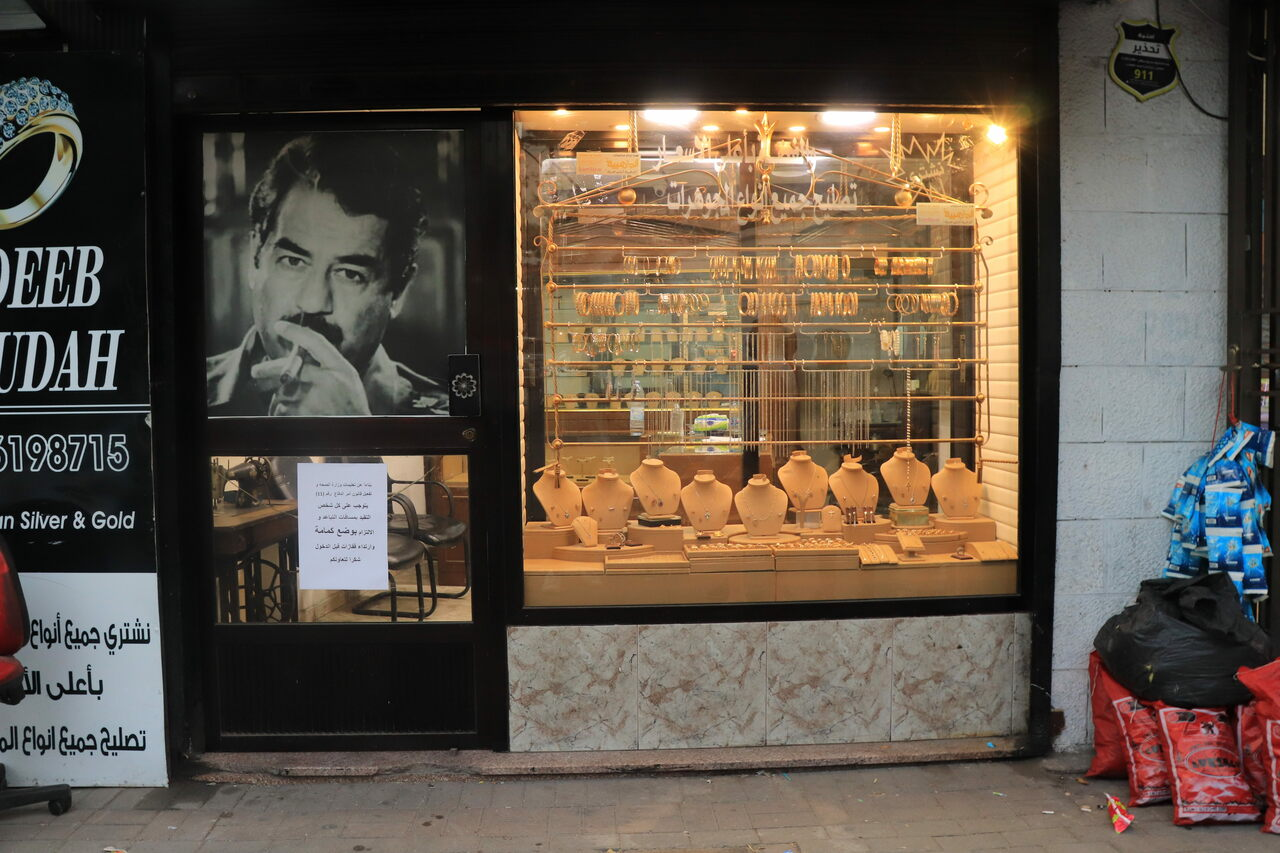 Saddam Hussein's face decorates the door of a gold shop in the Jabal Amman neighborhood of Amman. The owner, Adeeb, says his father studied in Baghdad before returning to Jordan and joining the intelligence service.