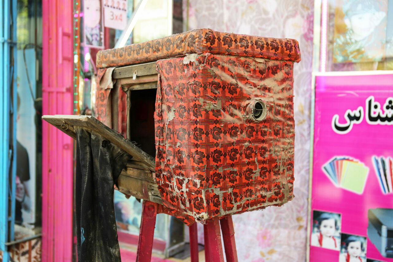 "The Afghan box camera—<em>kamra-e-faoree</em> (""instant camera"") in Dari—is housed in a brightly colored box to attract passersby."