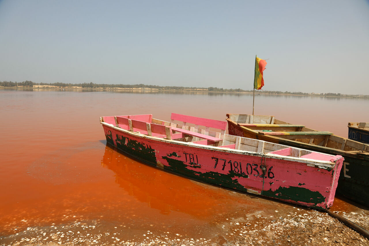 A pink boat for a pink lake. The water's color changes based on weather patterns and times of day.