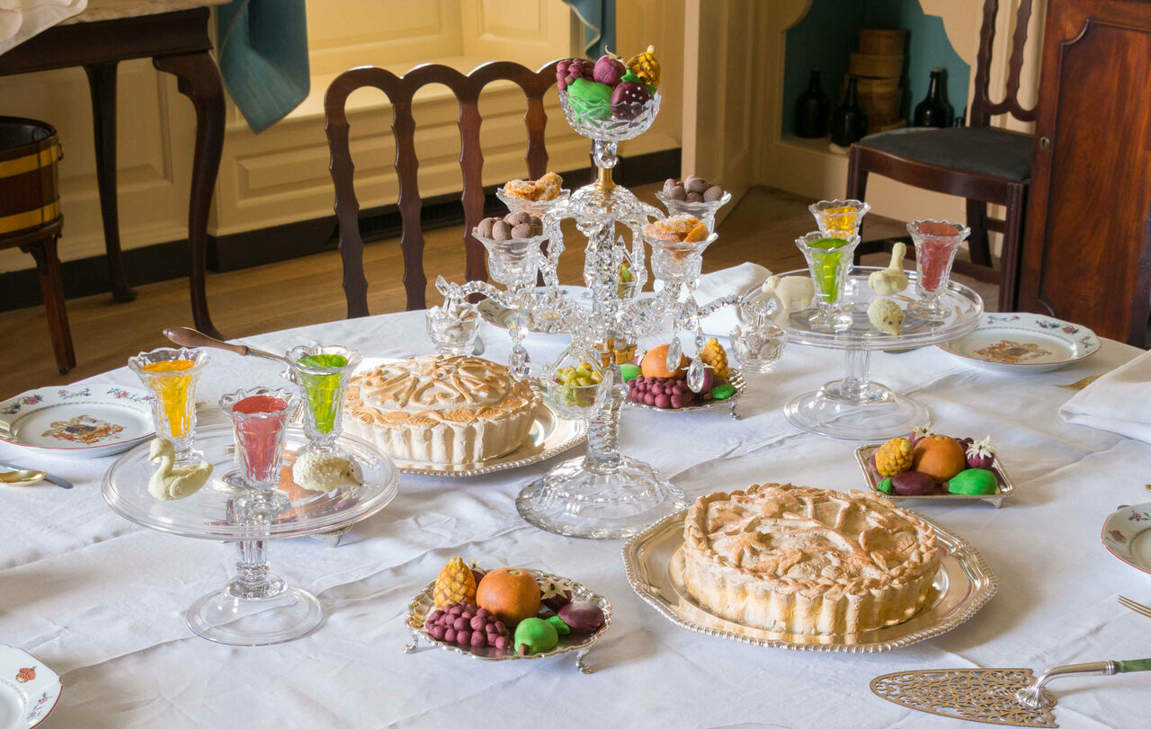 The Governor's Palace dining room in Colonial Williamsburg filled with fake jellies, candied ginger, chocolate almonds, pies, and marzipan fruits and animals.