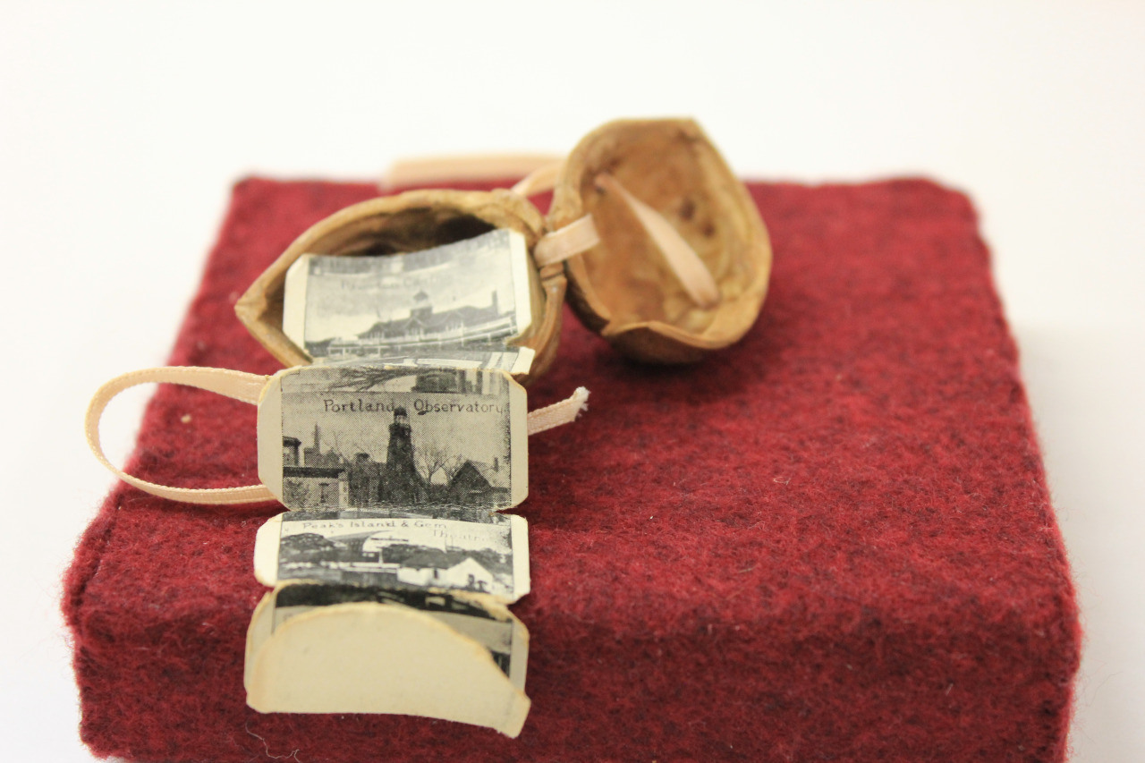 Popular in the early 20th century as souvenir books, these tiny books of travel photos (Maine, in this case) had tags attached so they could be dropped in the mail.