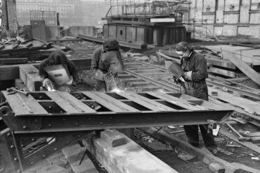 Acetylene welders dismantling the old Waterloo Bridge, 1944.