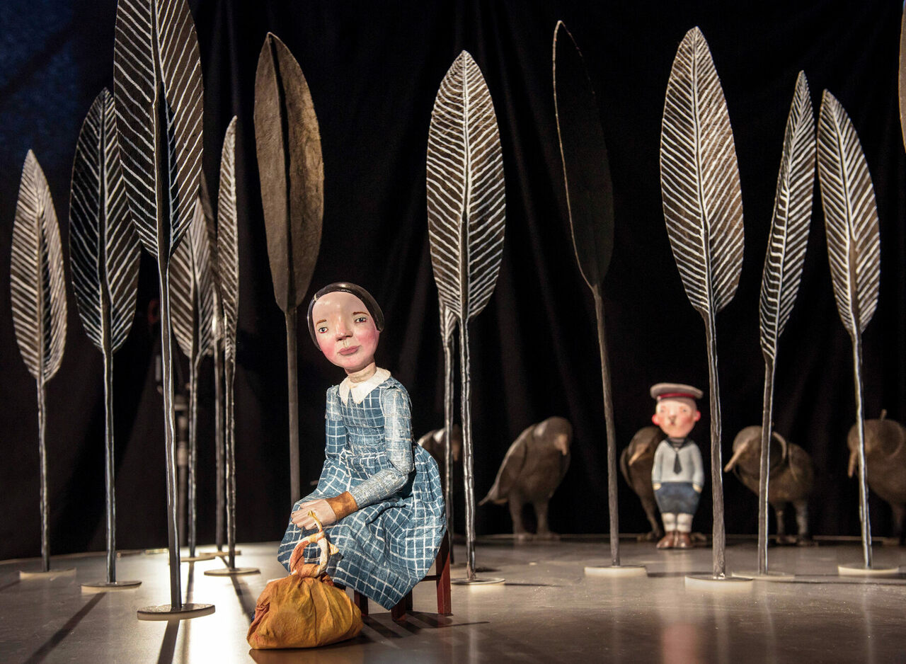 "Puppet performance of ""The Seven Ravens,"" a German folk tale by the Brothers Grimm, in which a young girl travels the world to look for her seven brothers, who have been turned into ravens."