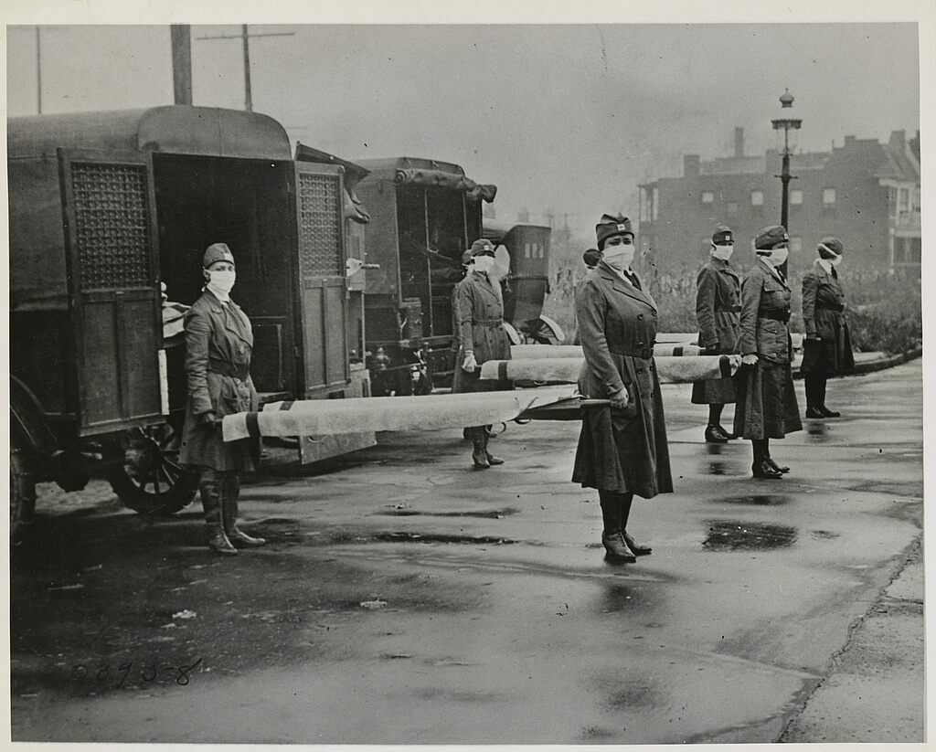 The St. Louis Red Cross Motor Corps on duty during the 1918 Influenza epidemic.