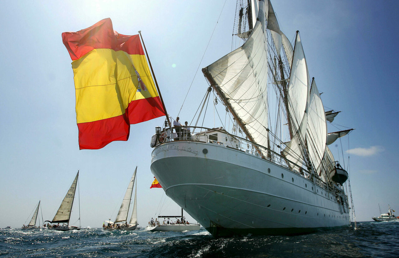 The Spanish tall ship <em>Juan Sebastian Elcano</em> leaves the port of Cadiz during the 50th edition of the Tall Ships Race in 2006. The vessel serves as both naval training tool and international envoy and emblem.