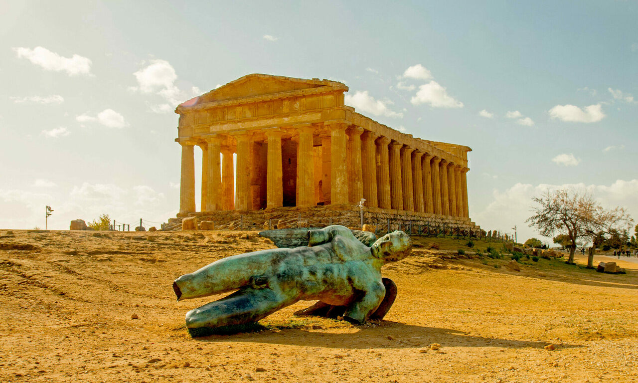 """The Valley of the Temples in Agrigento (including the more contemporary """"fallen"""" Icarus statue by the Polish artist Igor Mitoraj) is just one of the world's incredible ruin sites."""