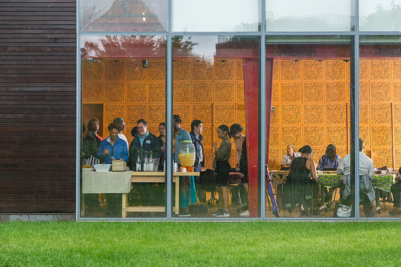 """A community dinner to celebrate the """"Meals as Collective Memory"""" project at Weeksville Heritage Center, which stands at the site of historic Weeksville."""