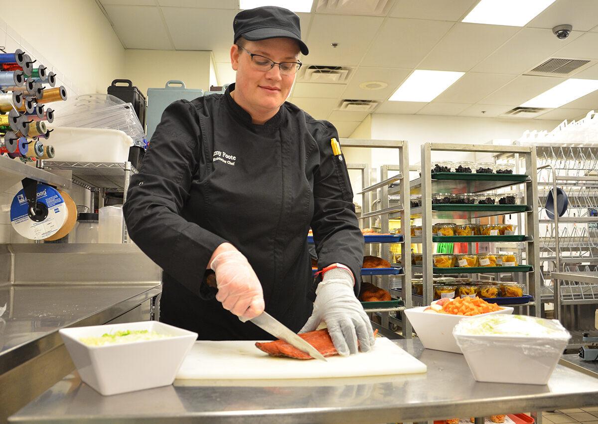 Chef Amy Foote preparing fresh Alaskan salmon for soup.